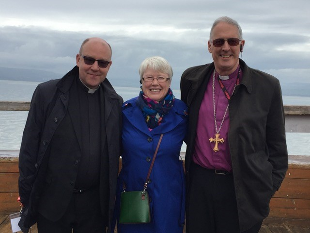 Nicole Burgum with the Bishop and Dean